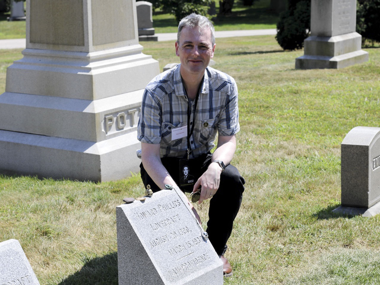 Paul Macelan at Lovecraft's grave